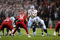 RALEIGH, NC - NOVEMBER 30: Sam Howell #7 of the University of North Carolina waits for the snap during a game between North Carolina and North Carolina State at Carter-Finley Stadium on November 30, 2019 in Raleigh, North Carolina.