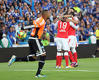 BOGOTA -COLOMBIA-12-04-2013:Jugadores de Santa Fe celebran el autogol  de Román Torres de Millonarios . (Foto: VizzorImage / Felipe Caicedo / Staff).  Santa Fe players celebrate goal by Torres Román Millionaire..(Photo: VizzorImage / Felipe Caicedo / Staff).Caicedo / Staff).Photo / VizzorImage / Felipe Caicedo / Staff