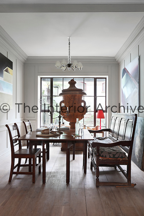 The dining room which doubles as a gallery is dominated by a huge ornate urn made of fibreglass