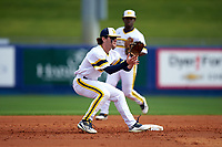 Michigan Wolverines shortstop Michael Brdar (9) waits for a throw as Ako Thomas (4) backs him up during the first game of a doubleheader against the Canisius College Golden Griffins on June 20, 2016 at Tradition Field in St. Lucie, Florida.  Michigan defeated Canisius 6-2.  (Mike Janes/Four Seam Images)