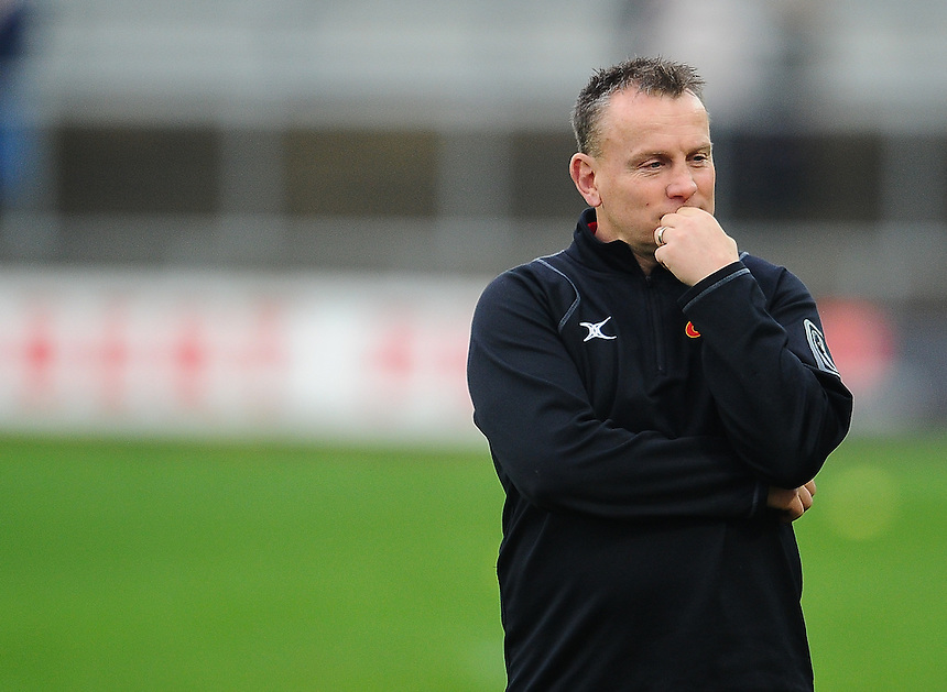 Dragons' Head Coach Kingsley Jones during the pre match warm up<br /> <br /> Photographer Craig Thomas/CameraSport<br /> <br /> Rugby Union - Guinness PRO12 - Round 10 - Newport Gwent Dragons v Cardiff Blues - Sunday 27th December 2015 - Rodney Parade - Newport<br /> <br /> &copy; CameraSport - 43 Linden Ave. Countesthorpe. Leicester. England. LE8 5PG - Tel: +44 (0) 116 277 4147 - admin@camerasport.com - www.camerasport.com