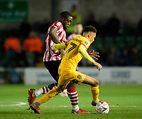 Lincoln City's John Akinde vies for possession with Northampton Town's Shaun McWilliams<br /> <br /> Photographer Chris Vaughan/CameraSport<br /> <br /> Emirates FA Cup First Round - Lincoln City v Northampton Town - Saturday 10th November 2018 - Sincil Bank - Lincoln<br />  <br /> World Copyright &copy; 2018 CameraSport. All rights reserved. 43 Linden Ave. Countesthorpe. Leicester. England. LE8 5PG - Tel: +44 (0) 116 277 4147 - admin@camerasport.com - www.camerasport.com