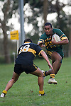 D. Raikuna gets aerial as he heads infield past a Bombay defender. Counties Manukau Premier club rugby game between Bombay & Pukekohe played at Bombay on the 19th of May 2007. Pukekohe led 24 - 0 at halftime & went on to win 30 - 22.