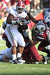 Alabama Crimson Tide running back Mark Ingram (22) is bottled up at the line of scrimmage by the Gamecock defense. South Carolina leads 21 over Alabama 9 at  the half.