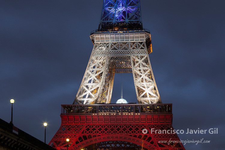 Eiffel tower with the colours of France after the attacks of 13 November 2015, Paris, Ile-de-france, France
