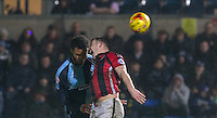 Shaun Beeley of Morecambe & Aaron Amadi-Holloway of Wycombe Wanderers in action during the Sky Bet League 2 match between Wycombe Wanderers and Morecambe at Adams Park, High Wycombe, England on 2 January 2016. Photo by Andy Rowland / PRiME Media Images