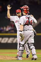 September 24, 2008:  Los Angeles Angels of Anaheim closer Francisco Rodriguez is congratulated by catcher Mike Napoli after notching his 62nd save of the season against the Seattle Mariners at Safeco Field in Seattle, Washington.
