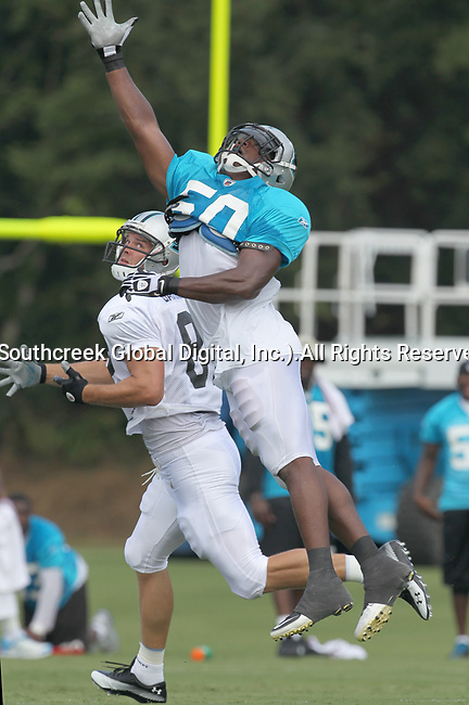 30July2010: Carolina Panther linebacker James Anderson (#50) and tight end Gary Barnidge (#82) go for a pass during practice. The Panthers held an afternoon training camp session at Wofford College in Spartanburg, South Carolina.