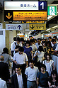 Yokohama, Japan - Japanese people rush to transfer trains at Yokohama Station. Morning commuters typically spend over one hour on the train going to work. Trains are usually so packed that train platform staff have to push commuters to fit in the train so that the doors can close shut. (Photo by Yumeto Yamazaki/AFLO)