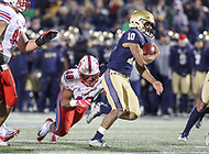 Annapolis, MD - November 11, 2017: Navy Midshipmen running back Malcolm Perry (10) gets tackled by Southern Methodist Mustangs linebacker Anthony Rhone (48) during the game between SMU and Navy at  Navy-Marine Corps Memorial Stadium in Annapolis, MD.   (Photo by Elliott Brown/Media Images International)