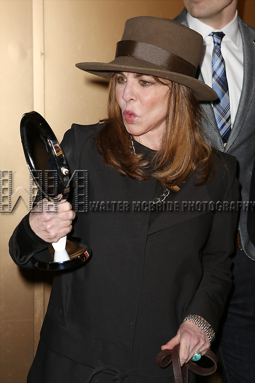Stockard Channing, with her mirror, and the cast from 'It's Only A Play' head to their new home at the Bernard B. Jacobs Theatre on January 23, 2014 in New York City.