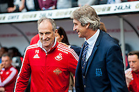 `sm shakes hands with Manuel Pellegrini, Manager of Manchester City prior to the Barclays Premier League match between Swansea City and Manchester City played at the Liberty Stadium, Swansea on the 15th of May  2016