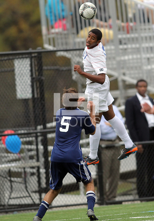 HYATTSVILLE, MD - OCTOBER 26, 2012:  Julian Dove (17) of DeMatha Catholic High School leaps up for a header over Camyer Matini (5) of St. Albans during a match at Heurich Field in Hyattsville, MD. on October 26. DeMatha won 2-0.