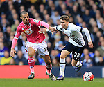 Tottenham's Tom Carroll tussles with Bournemouth's Lewis Grabban during the Premier League match at White Hart Lane Stadium.  Photo credit should read: David Klein/Sportimage