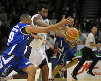 Saints guard Corey Webster tries to steal off Darryl Dora. NBL Semifinal - Wellington Saints v Nelson Giants at TSB Bank Arena, Wellington, New Zealand on Friday, 15 July 2011. Photo: Dave Lintott / lintottphoto.co.nz