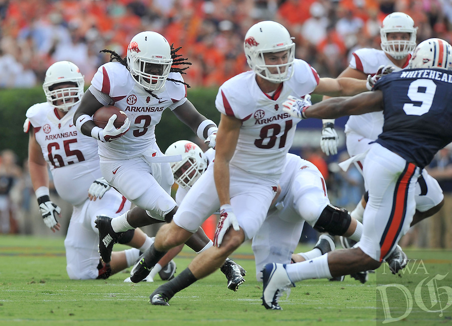 NWA Media/Michael Woods --08/30/2014-- w @NWAMICHAELW...University of Arkansas running back Alex Collins runs the ball up the middle during Saturday afternoons game against Auburn at Jordan-Hare Stadium in Auburn.