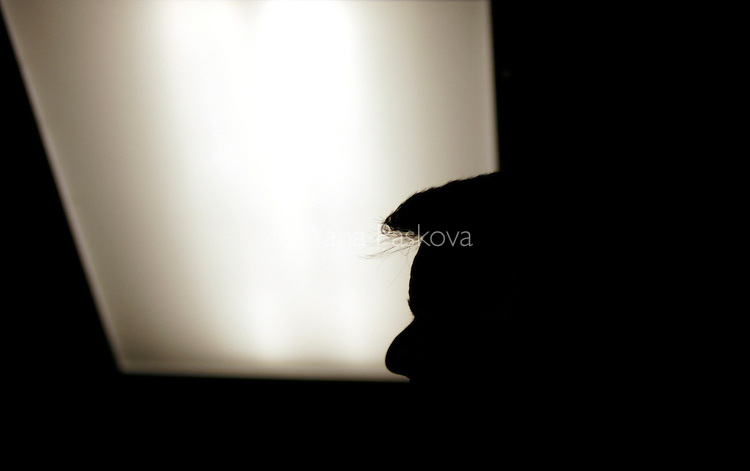 A ceiling light outlines the hair of U.S. Presidential hopeful John Edwards (D-NC) during a campaign stop in Des Moines, IA, on July 19, 2007.  Earlier this year, Edwards' campaign tab reportedly showed he paid $800 for two visits with Beverly Hills stylist Joseph Torrenueva.