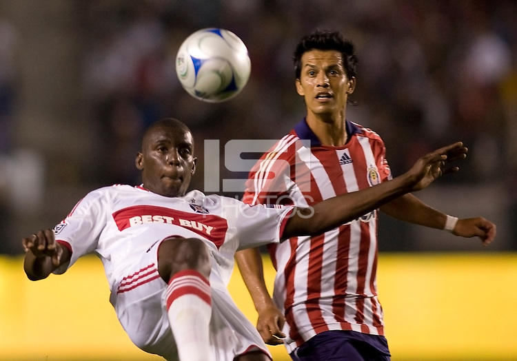 Chicago Fire defender Bakary Soumare keeps his eyes on the ball as Chivas USA forward Eduardo Lillingston observes. The Chicago Fire defeated Chivas USA 3-2 in extra time at Home Depot Center stadium in Carson, California on Thursday evening May 21, 2009.   .
