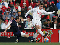DEC 3, 2005: College Park MD, USA: Maryland Terrapins midfielder (8) Robbie Rogers steps past Akron Zips midfielder (24) Yohann Mauger at Ludwig Field. Mandatory Credit: Photo By Brad Smith-International Sports Images (c) Copyright 2005 Brad Smith