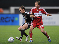 DC United defender Bryan Namoff (26) shields the ball against Chicago Fire midfielder Justin Mapp (21). The Chicago Fire tied DC United 1-1 at RFK Stadium, Saturday, March 28, 2009.