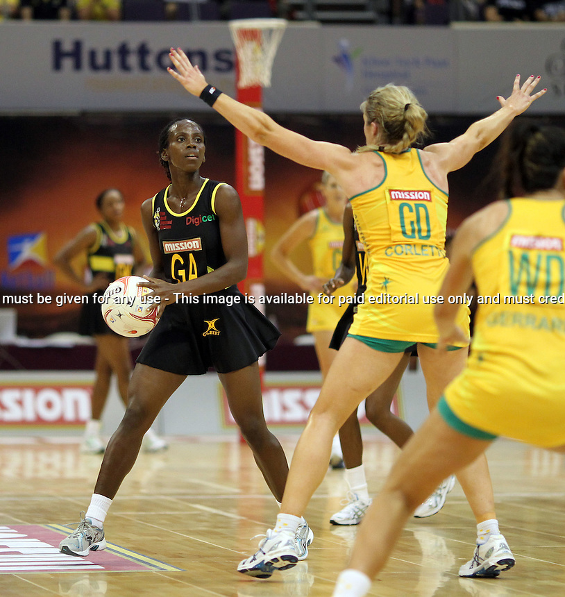 09.07.2011 Jamaica's Anna-Kay Griffiths in action during the netball match between Jamaica and Australia at the Mission Foods World Netball Championship 2011 held at the Singapore Indoor Stadium in Singapore . Mandatory Photo Credit ©Michael Bradley.