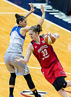 Washington, DC - Sept 17, 2017: Washington Mystics center Emma Meesseman (33) makes a move [ast Minnesota Lynx forward Cecilia Zandalasini (9) during playoff game between the Mystics and Lynx at the Verizon Center in Washington, DC. (Photo by Phil Peters/Media Images International)