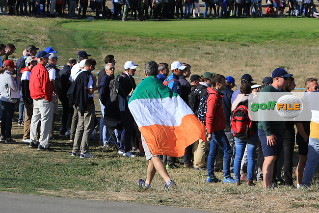 An Irish flag passes by the 11th during Saturday Foursomes at the Ryder Cup, Le Golf National, Ile-de-France, France. 29/09/2018.<br /> Picture Thos Caffrey / Golffile.ie<br /> <br /> All photo usage must carry mandatory copyright credit (© Golffile | Thos Caffrey)