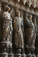 View from the side of Angel Gabriel, Virgin Mary, her cousin Elysabeth, annunciation group, right jamb statues of the central portal of the western facade of Notre-Dame de Reims (Our Lady of Rheims), pictured on February 15, 2009, 13th - 15th century, Roman Catholic Cathedral where the kings of France were crowned, Reims, Champagne-Ardenne, France.
