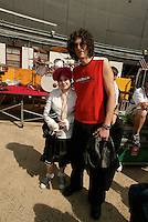 Kelly Osbourne and Howard Stern backstage at the K-Rock Dysfunctional Family Picnic at Jones Beach Theater in New York on June 8, 2002. Photo by Scott Gries/PictureGroup
