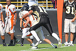 Palos Verdes, CA 09/22/11 - unknown Beverly Hills player(s) and Marco Catallo (Peninsula #10)) in action during the Beverly Hills-Peninsula Varsitty Football gane.) in action during the Beverly Hills-Peninsula Varsitty Football gane.) in action during the Beverly Hills-Peninsula Varsitty Football gane.