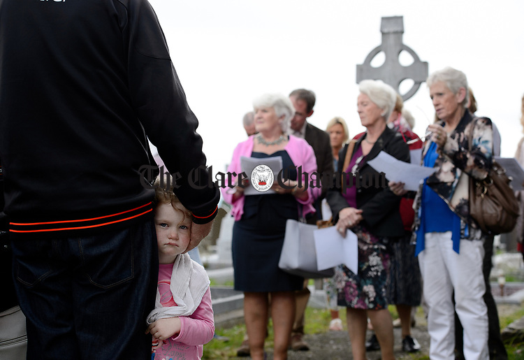 Little Erin Commane a great grand niece, at a commemorative service in Kilchreest cemetery to mark the one hundredth anniversary of the death of local man John Jacko Browne who was killed in the First World War and is buried in Saulty, France. Photograph by John Kelly.