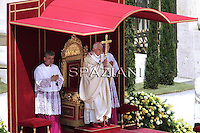 "May 1, 2011, Pope Benedict XVI kneels before the coffin of his predecessor Pope John Paul II in St. Peter's Basilica in the Vatican following his beatification. Pope Benedict XVI hailed John Paul II's ""strength of a titan"" in defending Christianity against ""a tide which appeared irreversible"" in a homily in Saint Peter's Square"