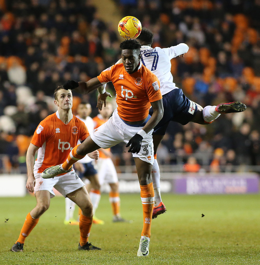Blackpool's Armand Gnanduillet battles with Luton Town's Pelly Ruddock-Mpanzu<br /> <br /> Photographer David Shipman/CameraSport<br /> <br /> The EFL Sky Bet League Two - Blackpool v Luton Town - Saturday 17th December 2016 - Bloomfield Road - Blackpool<br /> <br /> World Copyright &copy; 2016 CameraSport. All rights reserved. 43 Linden Ave. Countesthorpe. Leicester. England. LE8 5PG - Tel: +44 (0) 116 277 4147 - admin@camerasport.com - www.camerasport.com