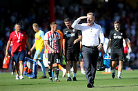 Brentford Manager, Dean Smith, walks off at the end of the match during Brentford vs Rotherham United, Sky Bet EFL Championship Football at Griffin Park on 4th August 2018
