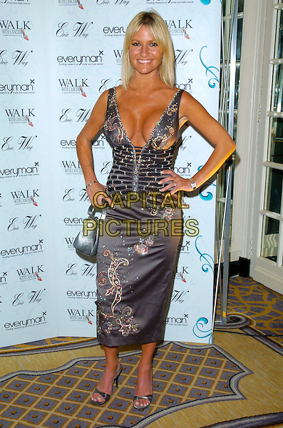 ALEX BEST.The Walk With Cancer Charity Ball, Savoy Hotel, London, England..June 7th, 2007.full length purple grey gray floral print embroidered dress low cut plunging neckline silver shoes bag purse cleavage hands on hips .CAP/CAN.©Can Nguyen/Capital Pictures