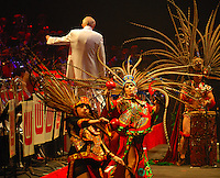 The Aztec Dancers perform with the UW Marching Band Thursday at the Kohl Center
