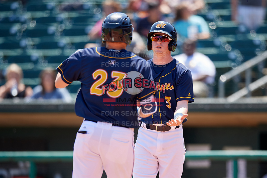 Montgomery Biscuits right fielder Ryan Boldt (23) is greeted by Jake Cronenworth (3) at home plate after hitting a home run in the bottom of the second inning during a game against the Biloxi Shuckers on May 8, 2018 at Montgomery Riverwalk Stadium in Montgomery, Alabama.  Montgomery defeated Biloxi 10-5.  (Mike Janes/Four Seam Images)