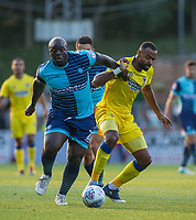 Adebayo Akinfenwa of Wycombe Wanderers holds off Liam Trotter of AFC Wimbledon during the Friendly match between Wycombe Wanderers and AFC Wimbledon at Adams Park, High Wycombe, England on 25 July 2017. Photo by Andy Rowland.