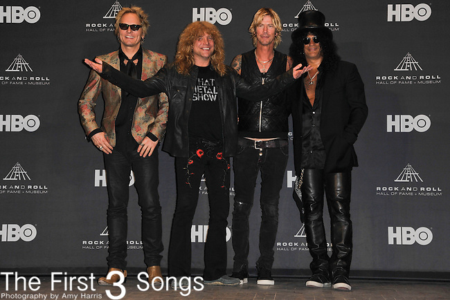 Slash, Duff McKagan, Steven Adler, and Matt Sorumin of Guns N' Roses the press room of the Rock & Roll Hall of Fame Induction Ceremony in Cleveland, Ohio on April 14, 2012.