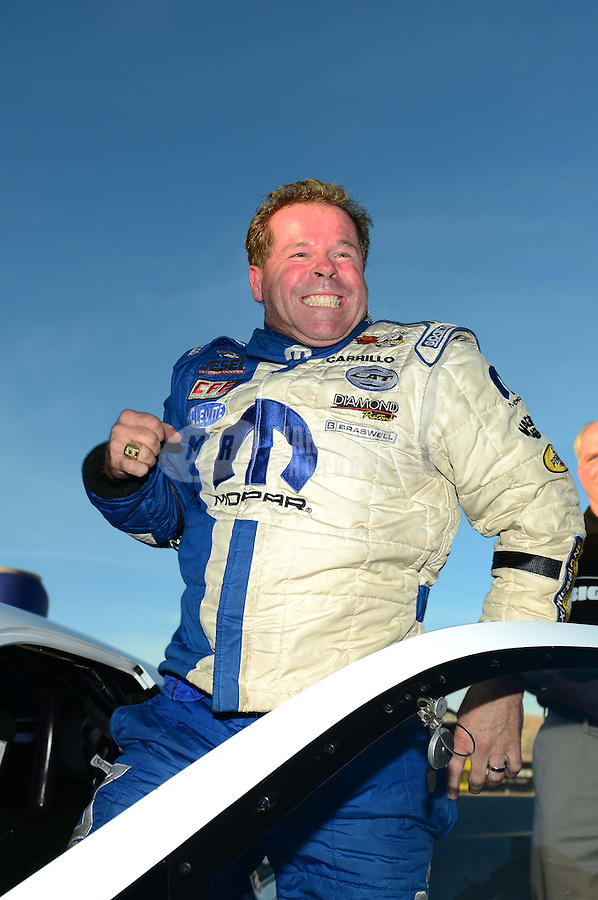 Oct. 28, 2012; Las Vegas, NV, USA: NHRA pro stock driver Allen Johnson celebrates after winning the Big O Tires Nationals at The Strip in Las Vegas. Mandatory Credit: Mark J. Rebilas-