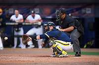 Michigan Wolverines catcher Harrison Wenson (7) and umpire Kyle Reese wait for the pitch during the second game of a doubleheader against the Canisius College Golden Griffins on February 20, 2016 at Tradition Field in St. Lucie, Florida.  Michigan defeated Canisius 3-0.  (Mike Janes/Four Seam Images)