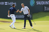 Lucas Herbert (AUS) and Adrian Meronk (POL) on the 18th green during the 3rd round of  the Saudi International powered by Softbank Investment Advisers, Royal Greens G&CC, King Abdullah Economic City,  Saudi Arabia. 01/02/2020<br /> Picture: Golffile | Fran Caffrey<br /> <br /> <br /> All photo usage must carry mandatory copyright credit (© Golffile | Fran Caffrey)