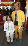Jay Kos & son.attending the opening night of the Broadway limited engagement of 'Fela!' at the Al Hirschfeld Theatre on July 12, 2012 in New York City.