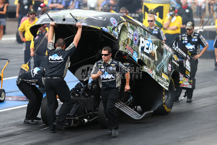 Jul 24, 2016; Morrison, CO, USA; Jon Schaffer , crew chief for NHRA funny car driver John Force during the Mile High Nationals at Bandimere Speedway. Mandatory Credit: Mark J. Rebilas-USA TODAY Sports