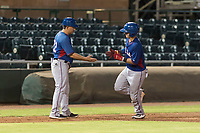 AZL Rangers catcher David Garcia (9) is congratulated by manager Matt Siegel (22) as he rounds third base after hitting a home run during an Arizona League game against the AZL Giants Black at Scottsdale Stadium on August 4, 2018 in Scottsdale, Arizona. The AZL Giants Black defeated the AZL Rangers by a score of 6-3 in the second game of a doubleheader. (Zachary Lucy/Four Seam Images)