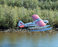 A bush pilot taking off on the river.