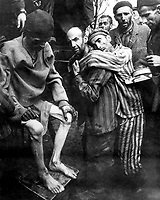 Wobbelin Concentration Camp, recently captured by troops of the 82nd Airborne Division.  Many prisoners were found nearly starved to death.  Here former prisoners are being taken to a hospital for medical attention.  Germany, May 4, 1945.  Pvt. Ralph Forney. (Army)<br /> NARA FILE #:  111-SC-206379<br /> WAR &amp; CONFLICT BOOK #:  1106