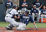 March 30, 2012:   Nevada Wolf Pack catcher Carlos Escobar Jr blocks the plate as BYU Cougars Tanner Chauncey slides home during their NCAA baseball game played at Peccole Park on Friday afternoon in Reno, Nevada.