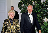 United States Secretary of Defense Dick Cheney and his wife, Lynne,, arrive at the White House in Washington, DC for the State Dinner in honor of President Patricio Aylwin of the Republic of Chile on Wednesday, May 13, 1992.<br /> Credit: Ron Sachs / CNP
