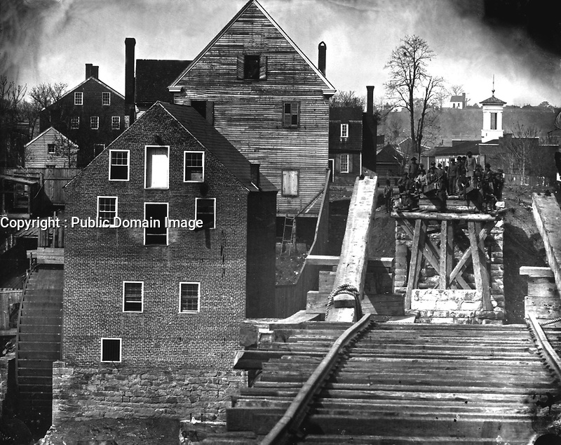 Fredericksburg, from the river.  Showing Confederate troops and bridge.  Taken at a distance of one mile.  Ca.  1863.  Mathew Brady Collection.  (Army)<br /> Exact Date Shot Unknown<br /> NARA FILE #:  111-B-438<br /> WAR & CONFLICT BOOK #:  175